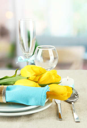 Spring table serving on bright background