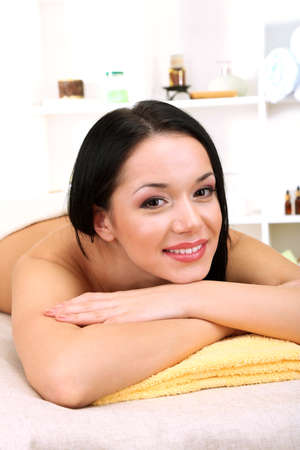 Beautiful young woman in spa salon, on bright background Stock Photo - 19360669