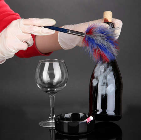 Taking fingerprints with bottle of wine isolated on black Stock Photo - 19038713