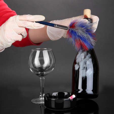 Taking fingerprints with bottle of wine isolated on black Stock Photo - 19038713