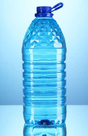 Big water bottle on blue background photo