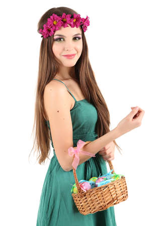 Happy female holding basket with Easter eggs, isolated on white photo