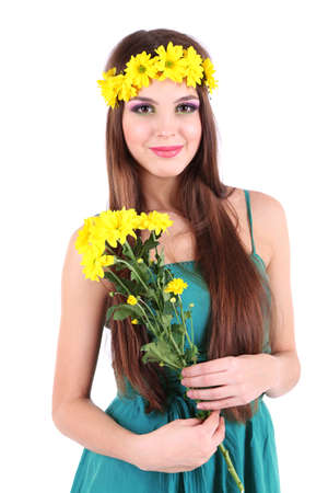 Young beautiful girl in green dress with nice flowers in her hand, isolated on white photo