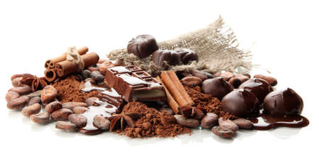 Composition of chocolate sweets, cocoa and spices, isolated on white photo