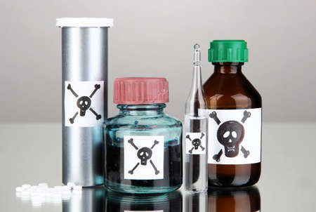 Deadly poison in bottles on grey background Stock Photo - 19039347