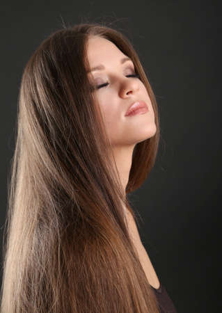 Portrait of beautiful woman with long hair on black background Stock Photo - 19360886