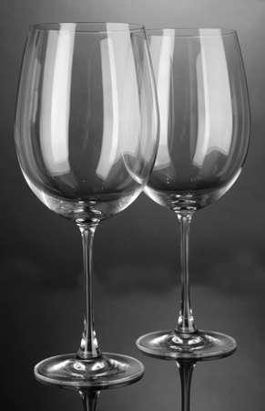 stemware: Empty wine glasses arranged on grey background Stock Photo