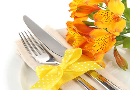 Festive dining table setting with flowers isolated on white photo