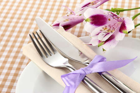 Festive dining table setting with flowers on checkered background Stock Photo - 19039796