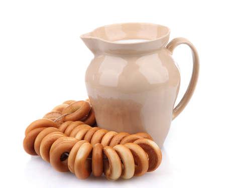 boublik: jar of milk, tasty bagels, isolated on white Stock Photo