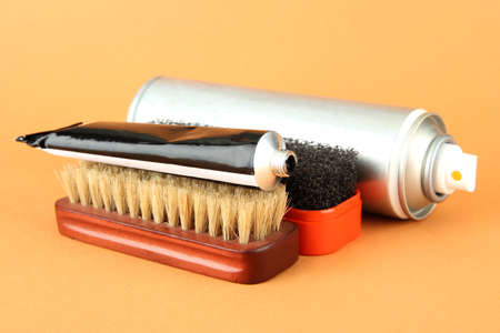 Set of stuff for cleaning and polish shoes, on color background Stock Photo - 19099160
