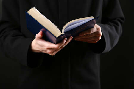 preaching: Priest reading from the holy bible, close up