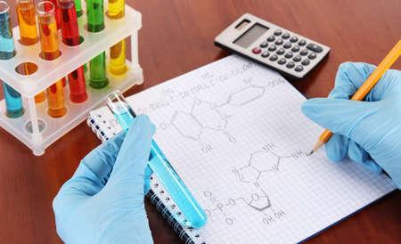 Hand scientist writing formulas photo