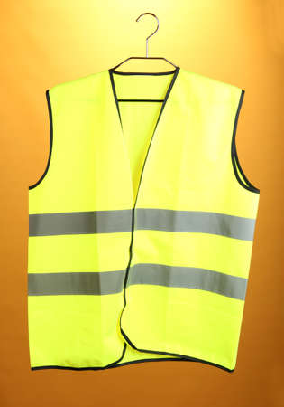 Yellow vest, on color background Stock Photo - 19099064