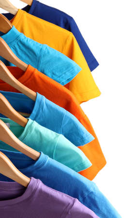 shirt hanger: Lots of T-shirts on hangers isolated on white