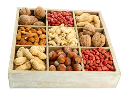assortment of tasty nuts in  wooden box, isolated on white photo
