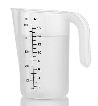 Measuring cup with water isolated on white photo