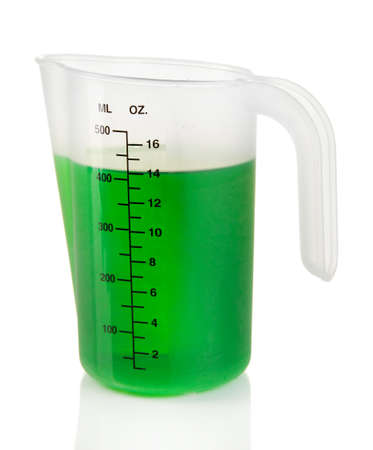 liter: Measuring cup with green liquid isolated on white Stock Photo