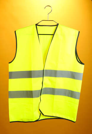 Yellow vest, on color background Stock Photo - 19224719