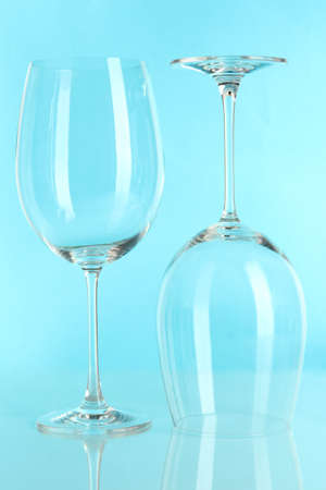 Two glasses on light blue background Stock Photo