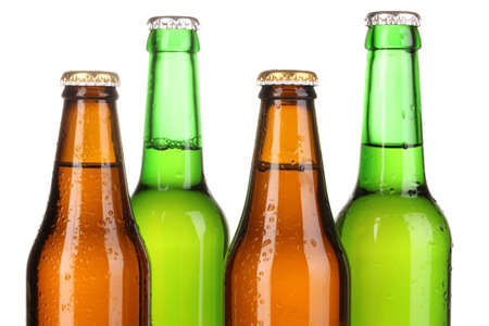 sopping: Coloured glass beer bottles isolated on white