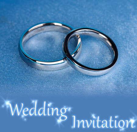 wedlock: Wedding rings on satin pillow close-up Stock Photo