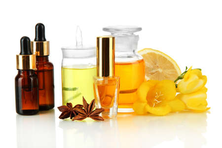 perfume oil: Bottles with ingredients for the perfume, isolated on white Stock Photo