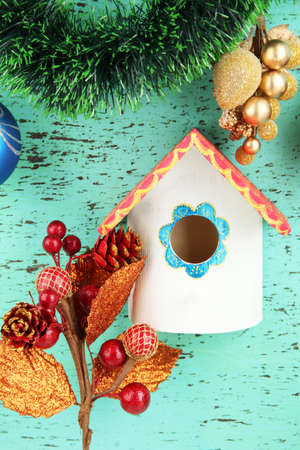 Nesting box  and Christmas decoration on blue background photo