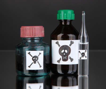 Deadly poison in bottles on black background Stock Photo - 19173461