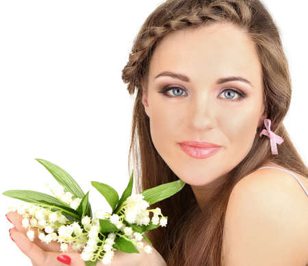 Young woman with beautiful hairstyle and flowers, isolated on white photo