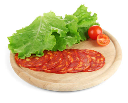Salami slices on wooden board, isolated on white photo