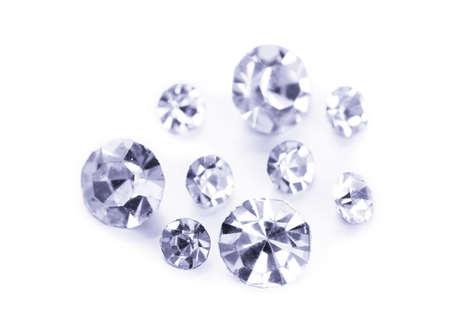 Beautiful shining crystals (diamonds), isolated on white photo