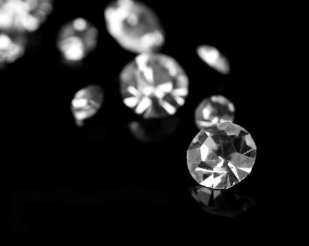 Beautiful shining crystals (diamonds), on black background photo