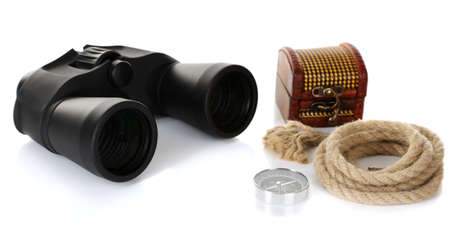 Black modern binoculars with rope and compass isolated on white photo