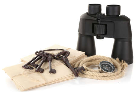 Black modern binoculars with old keys and letters isolated on white photo