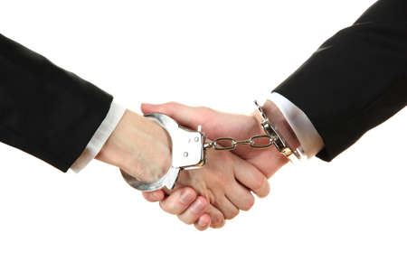 Man and woman hands and breaking handcuffs isolated on white background Stock Photo - 19227258