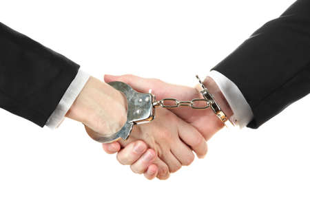 Man and woman hands and breaking handcuffs isolated on white background Stock Photo - 19227256