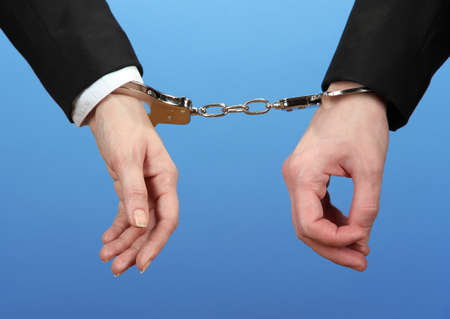 Man and woman hands and breaking handcuffs on color background Stock Photo - 19227309