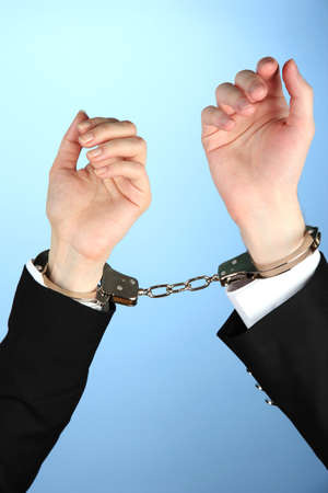Man and woman hands and breaking handcuffs on color background Stock Photo - 19227347