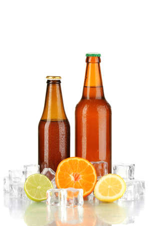 Beer bottles in ice isolated on white photo