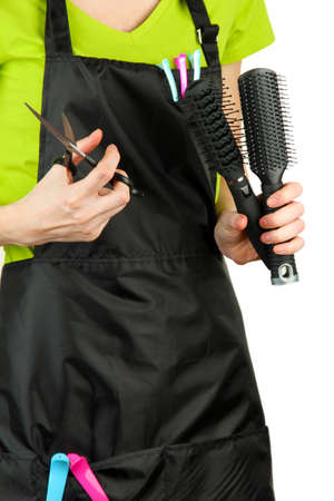 Hairdresser in uniform with working tools, isolated on white photo