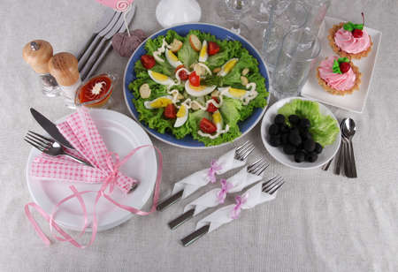 Table setting on tablecloth photo