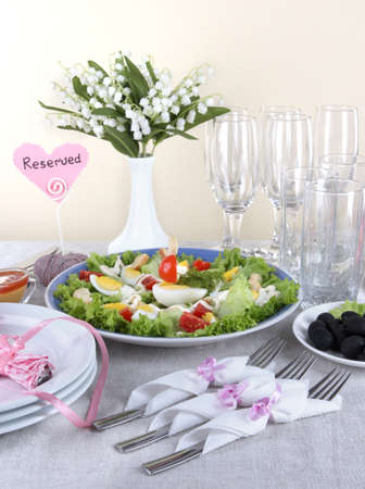 Table setting on beige background Stock Photo - 19248160