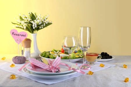 Table setting on yellow background Stock Photo - 19248567