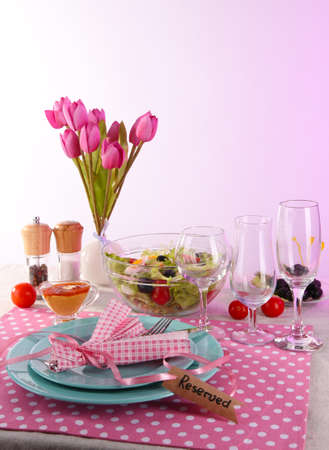 Table setting on pink background photo