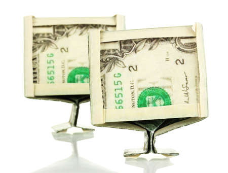 Dollars folded into computer monitors isolated on white photo