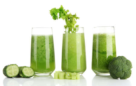 Glasses of green vegetable juice, isolated on white