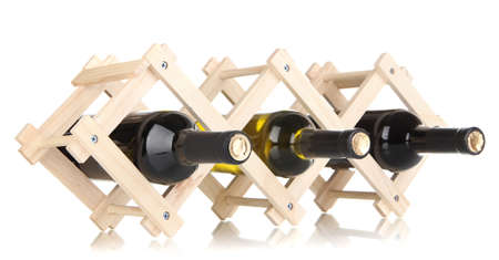 Bottles of wine placed on wooden stand isolated on white Stock Photo - 19252603