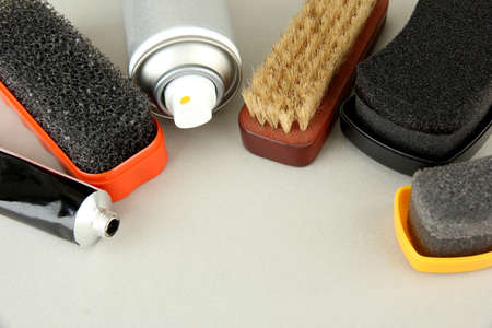 Set of stuff for cleaning and polish shoes, on color background Stock Photo - 19318814