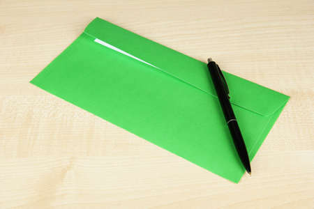 Envelope with pen on wooden background Stock Photo - 19291923
